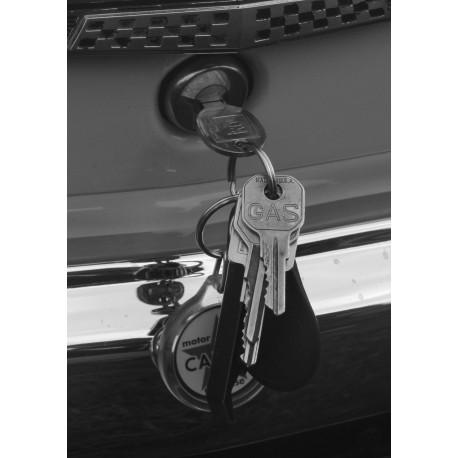 Poster med svartvitt fotografi på nycklar